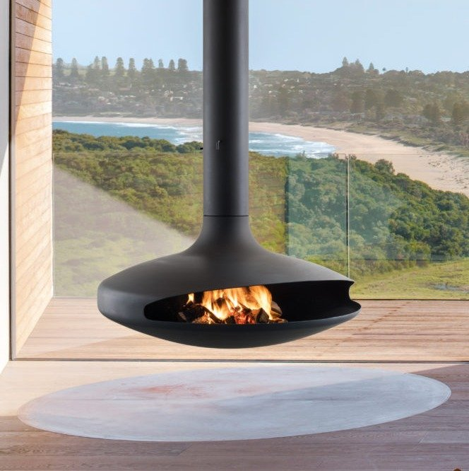 European Home Gyrofocus fireplace in front of a window