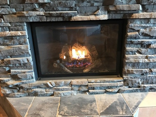 Kingsman gas insert fireplace installed by Alberta Wholesale Fireplaces